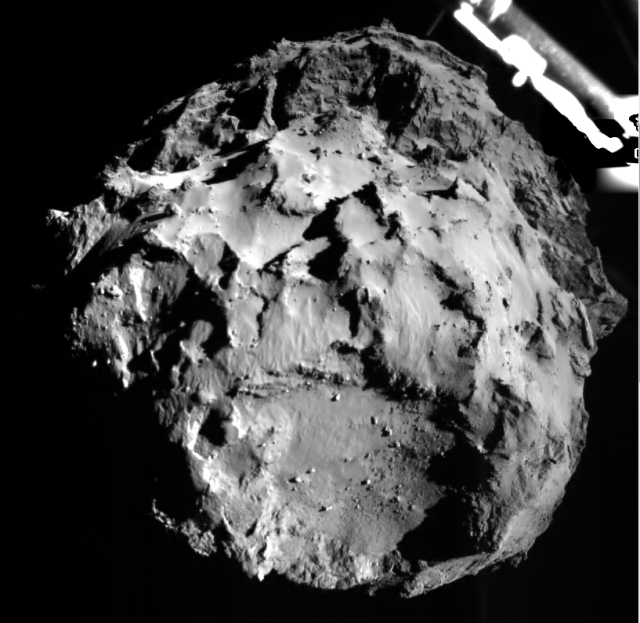 The image shows comet 67P/CG acquired by the ROLIS instrument on the Philae lander during descent on Nov 12, 2014 14:38:41 UT from a distance of approximately 3 km from the surface. The landing site is imaged with a resolution of about 3m per pixel. The ROLIS instrument is a down-looking imager that acquires images during the descent and doubles as a multispectral close-up camera after the landing. The aim of the ROLIS experiment is to study the texture and microstructure of the comet's surface. ROLIS (ROsetta Lander Imaging System) is a descent and close-up camera on the Philae Lander. It has been developed by the DLR Institute of Planetary Research, Berlin. The lander separated from the orbiter at 09:03 GMT (10:03 CET) and touched down on Comet 67P/Churyumov–Gerasimenko seven hours later.